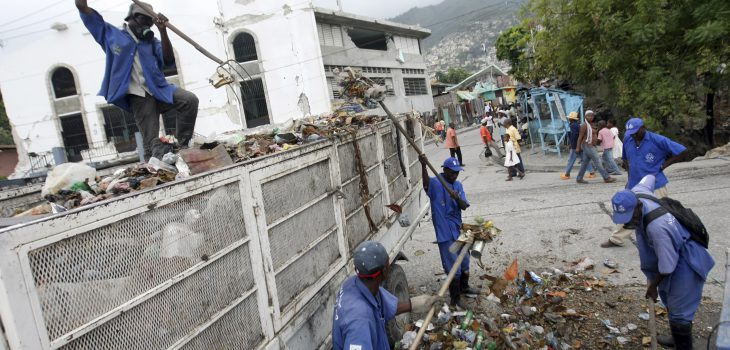 Workers from UNDP's Cash for Work program leave the Sant Triyaj Fatra in Kafoufey at 7 am every morning and walk down the mountain to clean the streets of this neighborhood of Port-au-Prince where most homes and buildings were completely destroyed in the earthquake that devastated Haiti on January 12th.  The street cleaners work in 6 hour shifts, 1500 people work in the morning and another 1500 people in the afternoon.