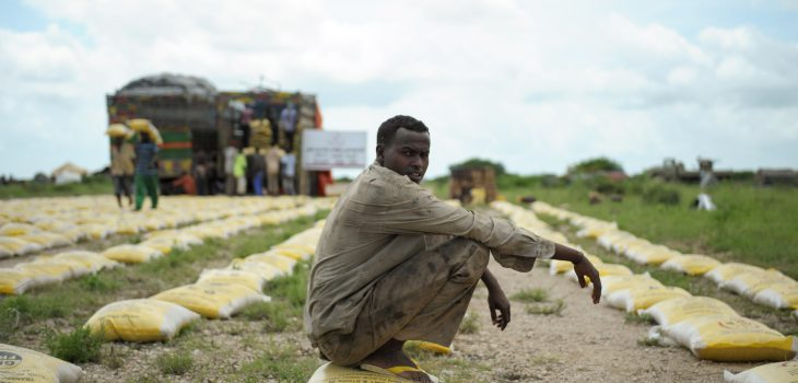 A man rests on a bag of rice donated by Qatar Charity for IDPs displaced by the recent flooding and clan conflict in Jowhar, Somalia, on November 12. Heavy rains in Somalia, coupled with recent disputes between clans, has resulted in over four thousand IDPs seeking shelter at an AMISOM military base near the town of Jowhar, with more arriving daily. AU UN IST Photo / Tobin Jones