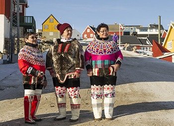 Secretary General Ban Ki Moon visits Uummannaq Greenland with the PM of Denmark and the PM of Greenland to witness the fastest moving glacier on the planet.  Indiginous  Inuit women in  them Uummannaq  community await the SG's arrival