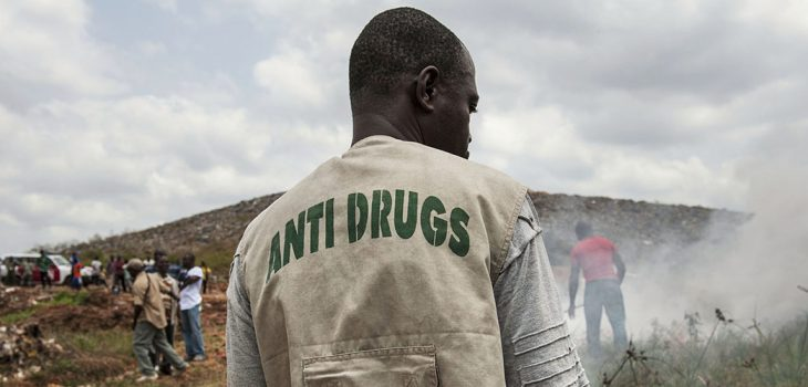 A Liberian Anti-Drugs Squad member reviews the area where the police have been burning nearly 400kgs of marijuana and other drugs at a municipal rubbish dump, outside Monrovia, Liberia, Friday 1 March, 2013.  The drugs had been confiscated over a one year period by the Liberian National Police. UNMIL Photo/Staton Winter